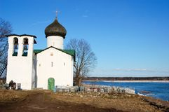 A small church and the bell tower of Princess Olga on the banks of the Great River, Russia, Pskov, the village of Vybuty royalty free stock photos