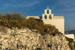 Small church with bell tower in town of Firostefani, Santorini island, Thira, Greece Stock Photos