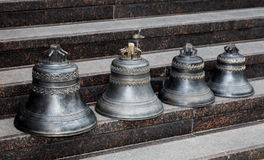 Small church bells stand Royalty Free Stock Image