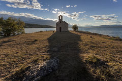 Small church, big shadow Royalty Free Stock Photos