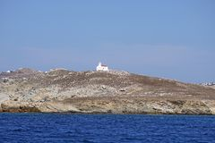 Small church that can be admired on the top of a island facing Mykonos. Small church that can be admired on the top of a small island facing Mykonos royalty free stock images