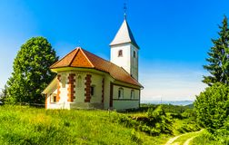 Small church of Cerkev sv. Ahaca by kamnik in the mountains of Slovenia royalty free stock photo