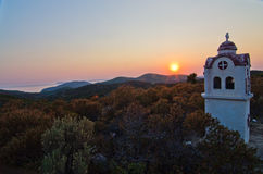 Small church or chapel with typical Greek landscape at sunset Royalty Free Stock Images