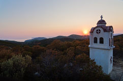 Small church or chapel with typical Greek landscape at sunset in Sithonia Royalty Free Stock Image