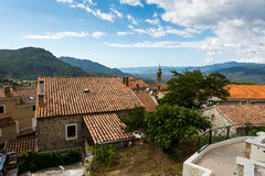 Small church at Corsica. Small church in Corsica village. In background are sea and mountains royalty free stock photography