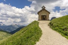 A small church in the Dolomites. Viewpoint Passo Pordoi. Italy. A small church in the Dolomites. Viewpoint Passo Pordoi. Italy Stock Images