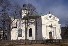 Small church exterior. Small church of Hameenlinna in Finland. Early spring sun shining straight to the white walls of the building Royalty Free Stock Photos