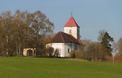 Small church on a field. Royalty Free Stock Image