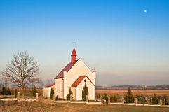 Small church in a field Stock Photo