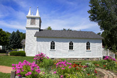 Small church and flower garden. Small historic church in South Lyon downtown Michigan Stock Photos