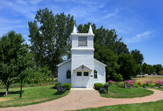 Small church and flower garden. Small historic church in South Lyon downtown Michigan Royalty Free Stock Photography