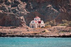 Small church on a rocky seashore in Greece stock images