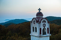 Small church in Greek coastal landscape at sunset, Sithonia Stock Photos