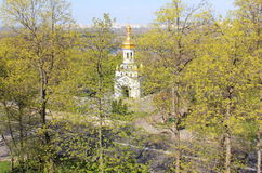 Small church in the green trees. Royalty Free Stock Image