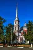Small church. A small Church with a high spire and a cross on it Stock Photo