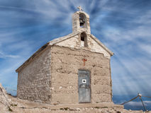 Small church on the highest top of the Mountain. royalty free stock photo