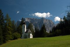 Small church in mountain. Small church i mountain, on the bacground mountain Zugspitze Stock Photos
