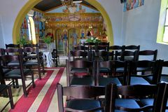 Small church inside with icons and chairs in Europe stock image