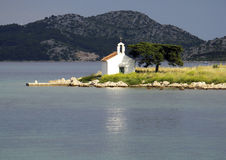 Small church on island. Scenic view of small church on island near Pakostane, Croatia Stock Photos