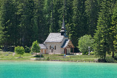 Small church on lake shore Stock Image