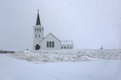 Small church in landscape at Iceland, falling snow Royalty Free Stock Images