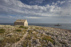 Small church and lighthouse Royalty Free Stock Image