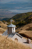 A small church in the Macedonian mountains. A small church of Parumba in the Macedonian mountains, Lake Ohrid visible Stock Photos