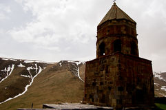 Small church in the mountains of caucasus views from giorgia Royalty Free Stock Photos