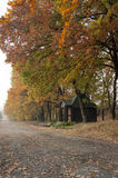 A small church near the road from the beautiful autumn trees wit Stock Image
