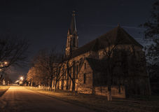 Small church at night. Small village church in the moonlight Stock Photography