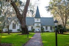 Small Church Past Brick Walk and Green Lawn Horizontal Stock Images