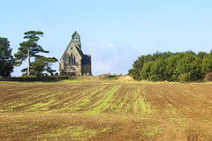 Small church and plowed field Royalty Free Stock Photos