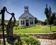 Small church in Reno, Nevada. A small church near Reno, Nevada with a slightly creepy looking child statue Royalty Free Stock Photos