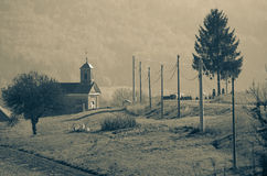 Small church by the road. By the road near the town of Planina in Slovenia stands a church with a small graveyard Royalty Free Stock Photography