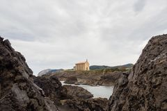 Small church of Santa Catalina on the coast of Mundaca village in Biscay during a cloudy day. Spain royalty free stock images