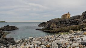 Small church of Santa Catalina on the coast of Mundaca village in Biscay during a cloudy day. Spain stock image