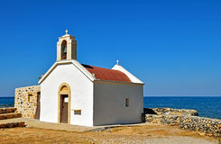 Small church by the sea in Chersonissos on the island of Crete, Greece Stock Photography