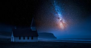 Small church by sea in Iceland with stars at night. Europe Royalty Free Stock Photos