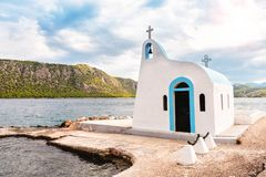 A small church on the shores of the sea lake stock photo