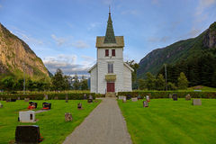 Small church in the slopes of the mountains Stock Image