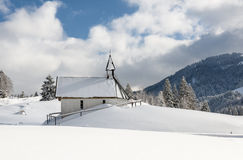 Small church in snowy alps Royalty Free Stock Images