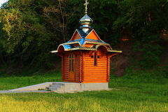 Small church. Of spring green trees is a wooden church Royalty Free Stock Image
