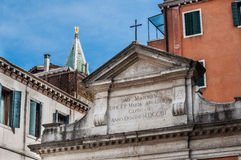Small church and St Marks Campanile with gilden angel Royalty Free Stock Images