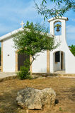 Small church with tree Stock Images