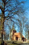 Small church in trees. A path leading to a small rural church surrounded by trees Stock Image