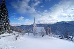 Small church in winter. In slovenian mountains Royalty Free Stock Images