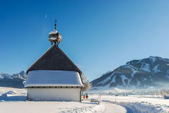 Small Church in Winter in the Austrian Alps. Royalty Free Stock Photo