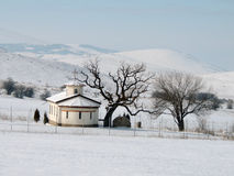 Small Church in Winter Countryside. Bright winter day, small Orthodox Church in the countryside, Bulgaria Stock Photos