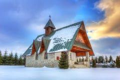 Small church in winter scenery near Zakopane Stock Photo