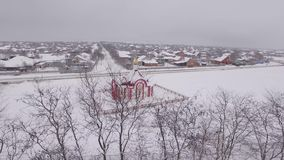 A small church in the winter, aerial photography stock video